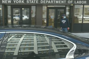 Luis Mora stands in front of the offices of the New York State Department of Labor in New York City in May 2020. For unemployed Americans, getting benefits they are entitled to starts with their state unemployment office.