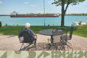 Fred Miller sits outside his St. Clair, Michigan, home, overlooking the St. Clair River.