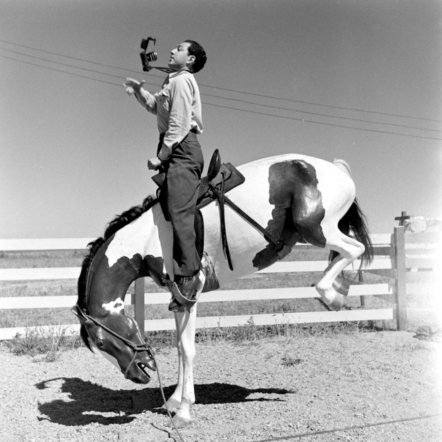 LIFE photographer Allan Grant clowns around during an assignment along Route 30, 1948.