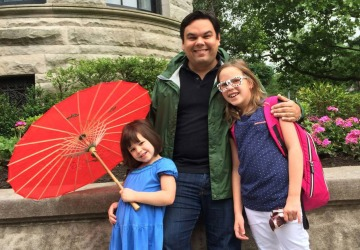 Robert Lopez with his daughters