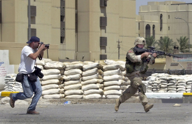 David Guttenfelder photographs U.S. troops in Baghdad in July 2004 during a search of a neighborhood near Baghdad's Martyrs' Square.