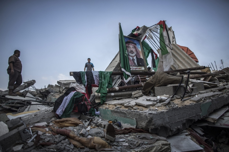 A picture of deputy chief of the Hamas movement, Ismail Haniya, is displayed amidst the rubble of his house, which was destroyed in an overnight Israeli airstrike in Gaza City, July 29, 2014.