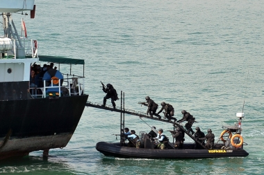 Indonesian troops storm a 'hijacked' vessel during a military simulation, off the Batam Island in Indonesia, in 2012.