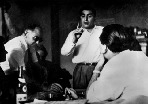 From left to right: David 'Chim' Seymour, Werner Bischof (in the background) and Robert Capa (pointing his finger) in Magnum Photos' Paris office in 1947.
