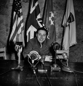 LIFE photographer/war correspondent Ralph Morse's self-portrait in the same chair from which General Eisenhower announced Allied victory in Europe.