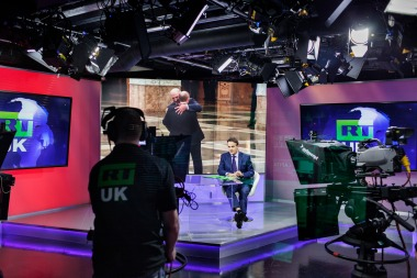 Anchor Bill Dod presents the news at RT's London studios