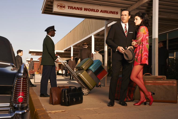 Don Draper (Jon Hamm) and Megan Draper (Jessica Pare)