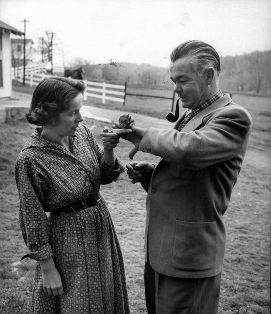 Trainers Marian and Dr. Keller Breland with their pet hamster, 1955.