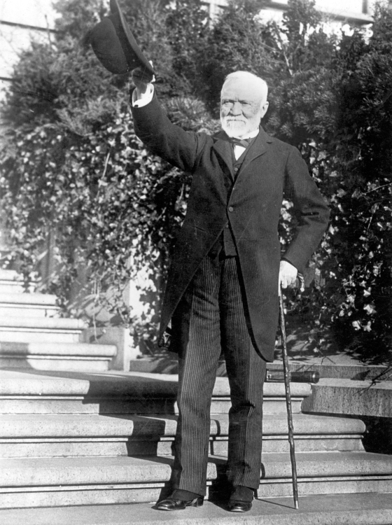Andrew Carnegie standing on the steps of his estate, circa 1910s.