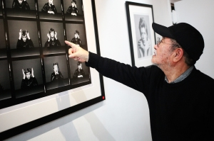 Masayoshi Sukita points out his favorite image from his shoot with David Bowie for the Heroes album cover at the Morrison Hotel Gallery in New York City on Nov. 13, 2015.