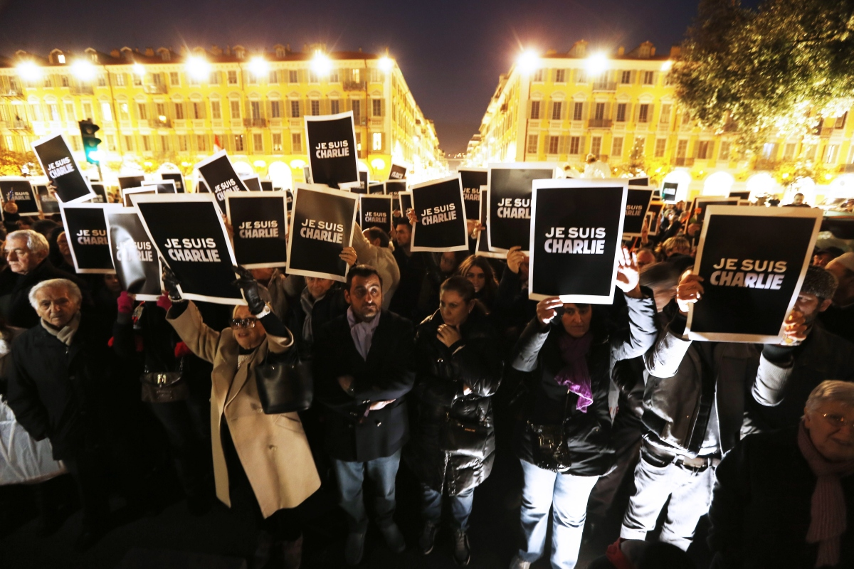"""People hold up placards reading """"I am Charlie"""" during a gathering in Nice on Jan. 7, 2015, in support of the victims of a terrorist attack on French satyrical newspaper Charlie Hebdo."""