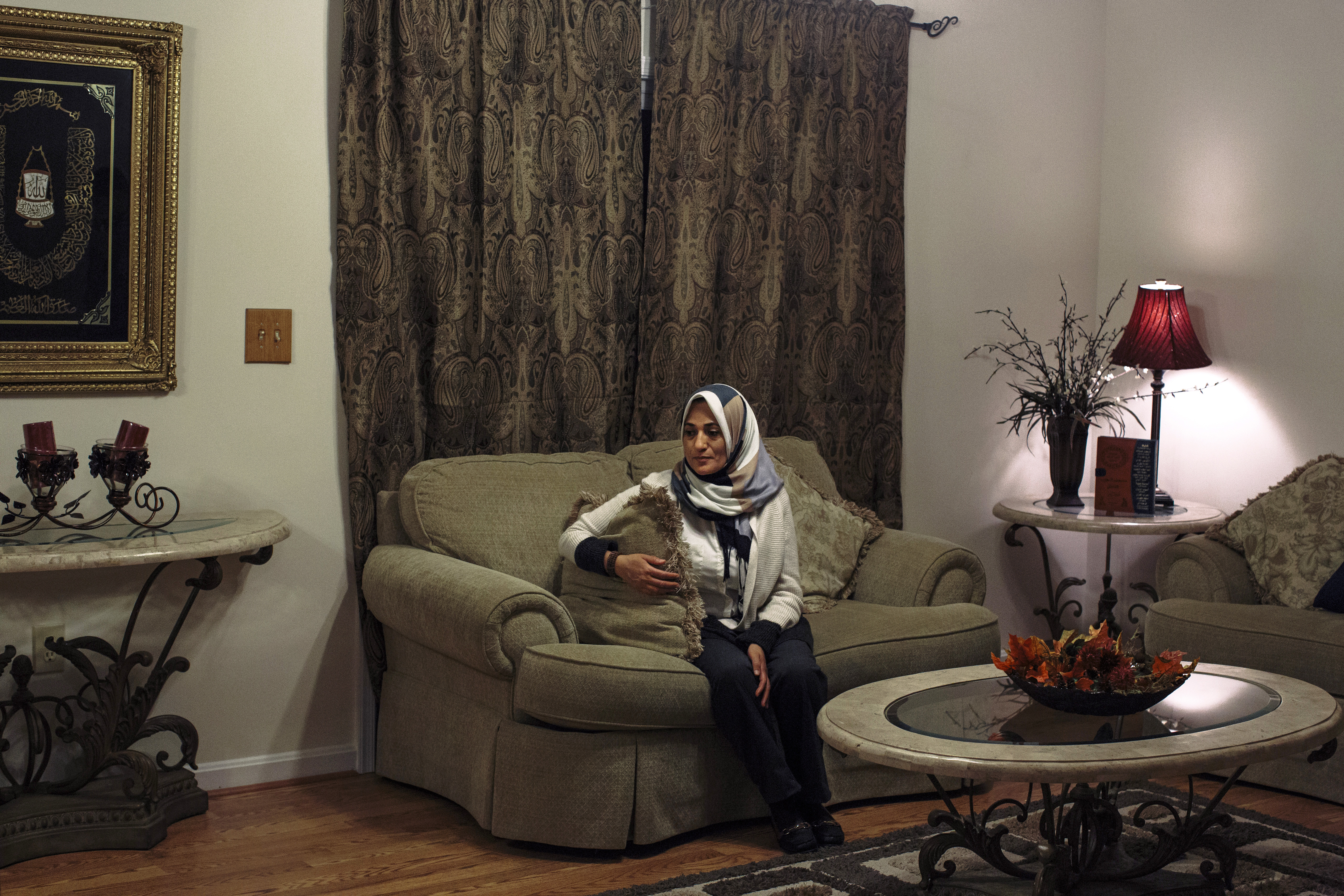 """Sanaa Soliman sits in the living room of her home in Fredericksburg, Va. on Dec. 19, 2015. Sara and Mohamed Shanab are afraid for their mother, who wears a hijab. Sara bought her mother pepper spray. """"I see my mother. Everyone else sees a terrorist,"""" Mohamed says."""