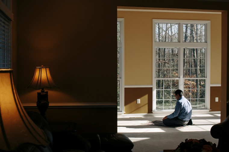DECEMBER 19, 2015 - FREDERICKSBURG, VA - Muhammed Asif, prays at his home in Spotsylvania, Va. Asif and his wife Saima Rana were planning to vote Republican in the next presidential election due to tax policies, but after hearing anti-Islamic rhetoric from the candidates, they say they will change their votes to Democrat.
