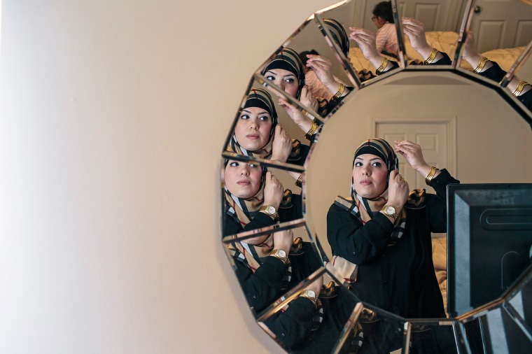 Yazmin Ali adjusts her hijab at her home in Fredericksburg, Va. on Dec. 19, 2015.