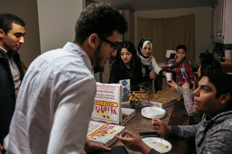 DECEMBER 19, 2015 - FREDERICKSBURG, VA - Sara Shanab, 19, center, and her brother Mohamed Shanab, 18, second from left, host a meeting with the Muslim Sutdent Assocation board members at their home in Fredericksburg, Va. The siblings decided to start a Muslim student group at their school, Germanna Community College. They have done charitable work through the club and plan to help facilitate social understanding about Islam.