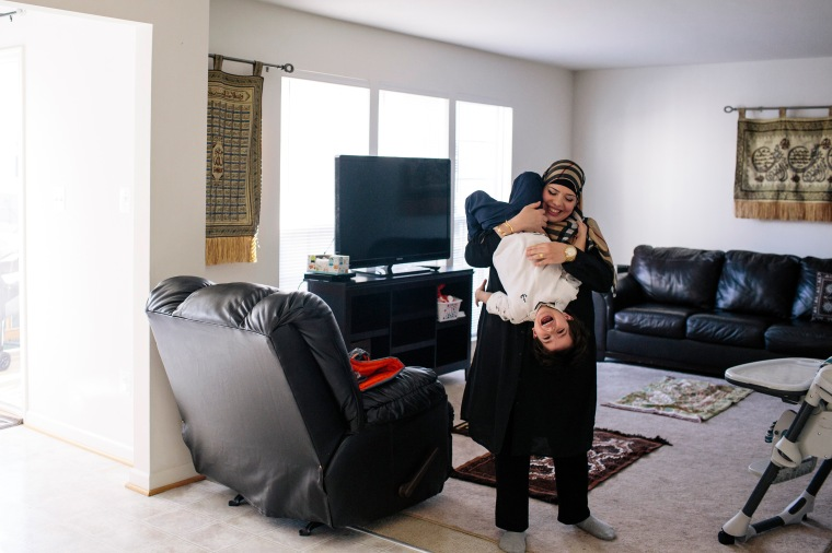Yazmin Ali plays with her son Karam Kady at their home in Fredericksburg, Va., on Dec. 19, 2015.