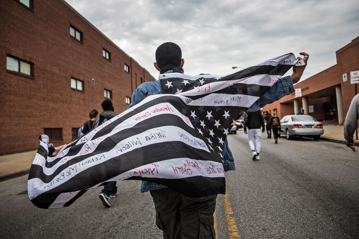 Demonstrators celebrate in Baltimore on May 1 after police officers were charged in connection with the death of Freddie Gray, who died in custody