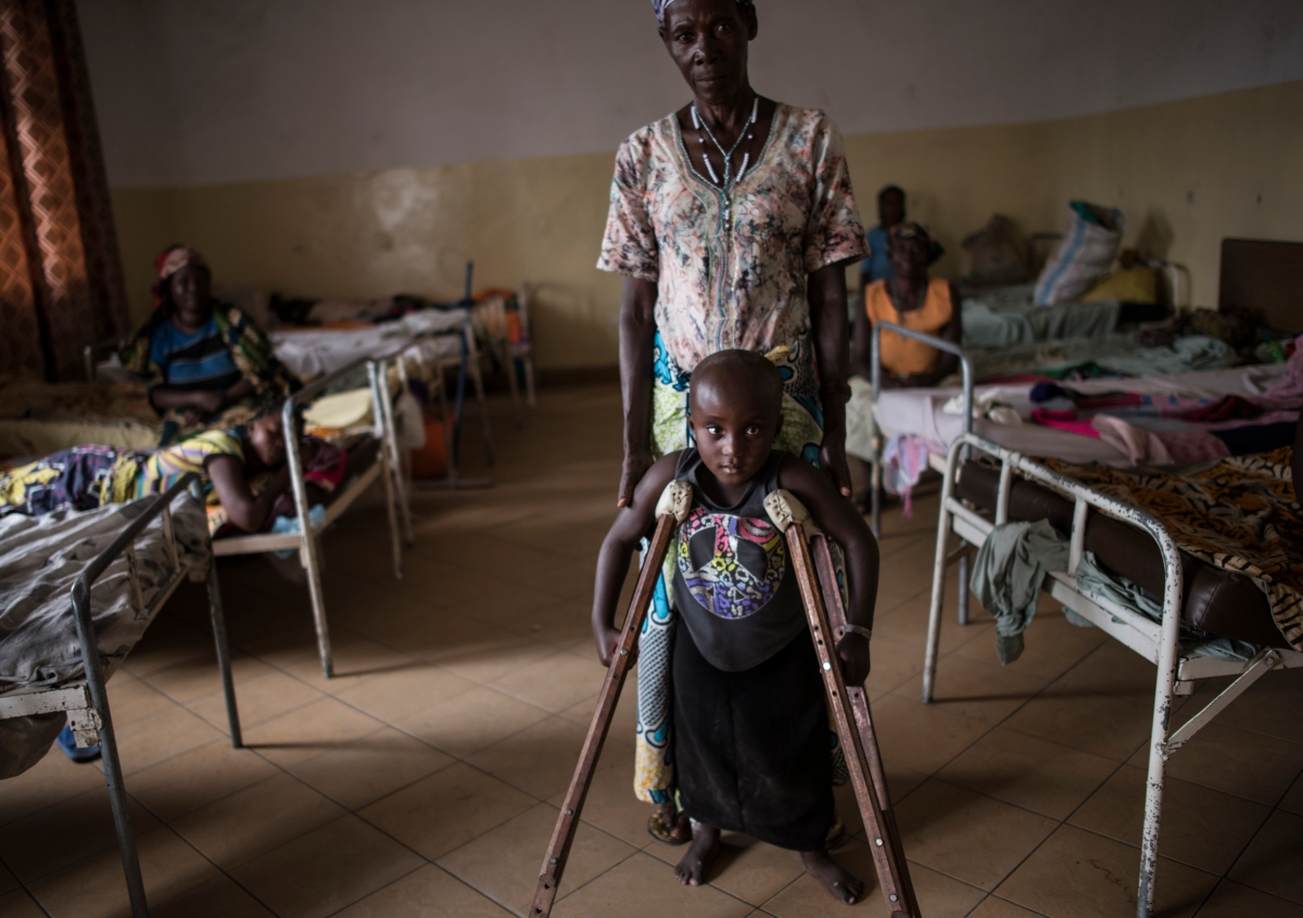 Kanyere Neema, 7, with her grandmother, Ndahondi Domina, 53, in the Heal Africa hospital in Goma, the Democratic Republic of Congo, Dec. 5, 2015. Two years prior, Kanyere's village of Ishasha was attacked by armed men, and her parents were killed in front of her. She was raped so many times by different men that she was left paralyzed, and stopped speaking.