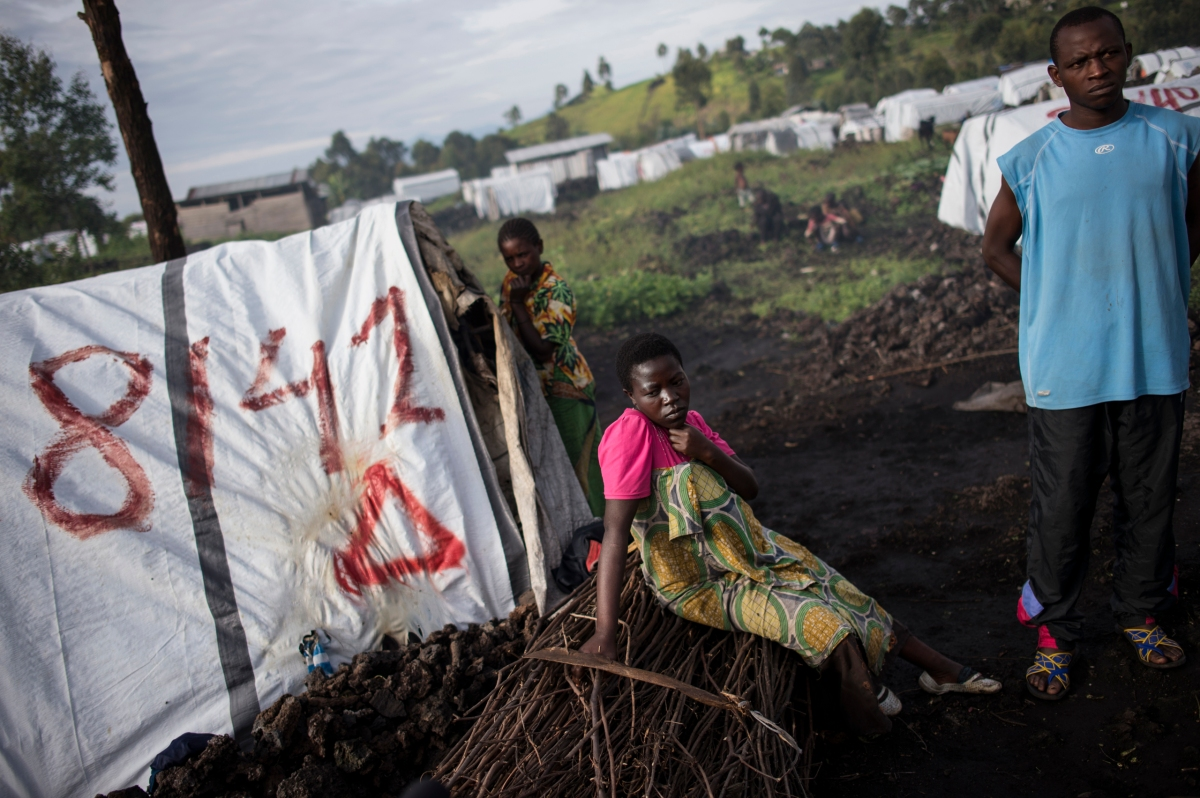 "span class=""credit""Lynsey Addario—Getty Images Reportage for TIME/spanspan class=""caption""Maiombi Thomas,16, sits alongside her brother, Innocent Kongomani, 22, in the Mugunga 1 camp for internally displaced people, outside Goma, the Democratic Republic of Congo, Dec. 5, 2015. Maiombi became pregnant after she was raped by a ranger when she went to get firewood outside the camp./span"