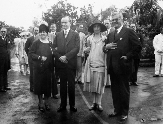 U.S. President Calvin Coolidge, second from left, and his wife, first lady Grace Coolidge, third from left, are shown with the President of Cuba General Gerardo Machado y Morales, right, and his wife, Elvira Machado, left, on the estate of President Machado in Havana, Cuba, Jan. 19, 1928.