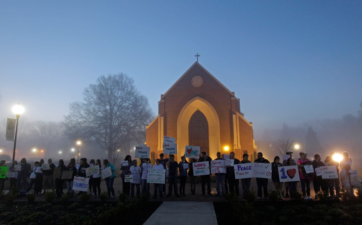 Protesters outside a church at Lenior-Rhyne University before a rally for Donald Trump in Hickory, N.C. on March 14, 2016.