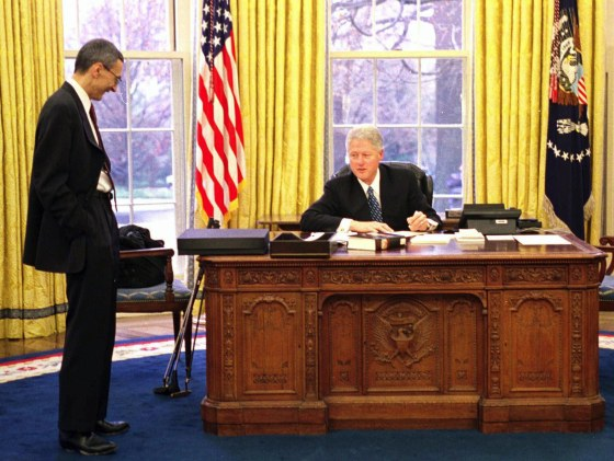 President Bill Clinton talks with White House Chief of Staff John Podesta on Jan. 20, 2001, in his last moments in the Oval Office before the president-elect's inauguration in in Washington.