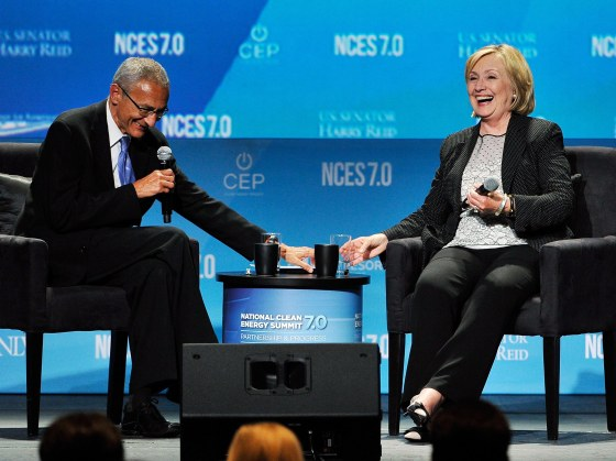 John Podesta, left, and Hillary Clinton attend the National Clean Energy Summit 7.0 on Sept. 4, 2014 in Las Vegas.