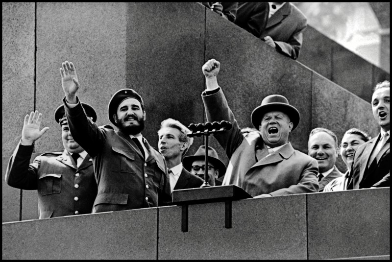 At the height of the Soviet-Cuban cooperation, Nikita Khrushchev welcomes Cuban President Fidel Castro at the podium of the Kremlin in front of the Red Square in Moscow, 1961.