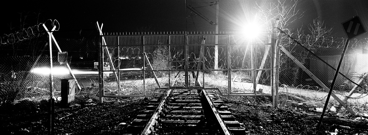 A closed gate of the railway passage at the Greek-Macedonian border next to a refugee camp near the village of Idomeni.