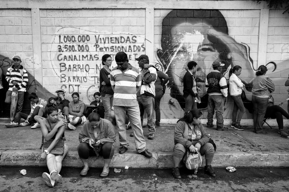 Residents of Barquisimeto wait on a food line, June 2016. Hunger across Venezuela is rising because of shortages. People often wait hours in lines that are miles long for meager supplies. As tension and discontent among the civilian population increases, violence has spread.