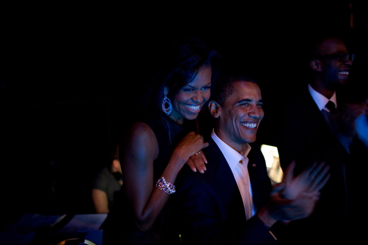 Barack Obama and Michelle Obama listen backstage to a concert by Bruce Springsteen and Billy Joel at Hammerstein Theater in New York City, Oct. 17, 2008.