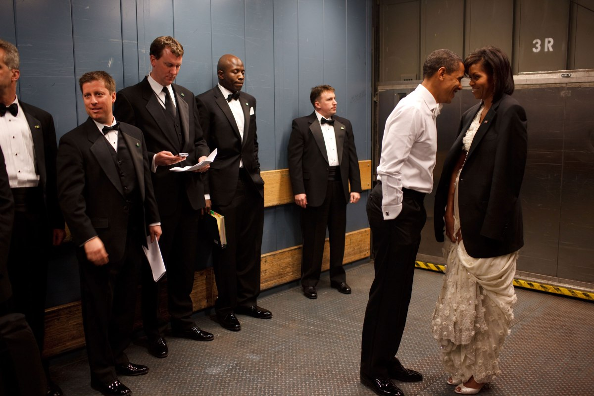 Barack Obama and Michelle Obama share a private moment in a freight elevator at an Inaugural Ball in Washington, D.C., Jan. 20, 2009.