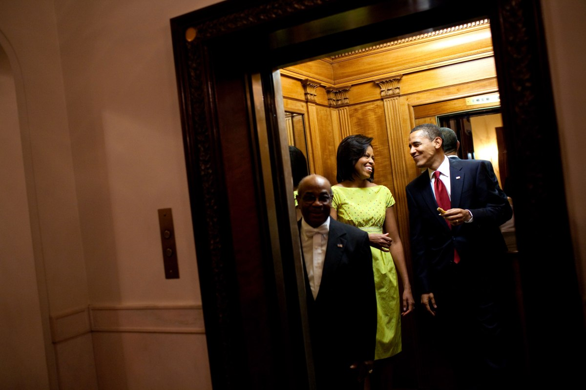 Barack Obama, holding a tortilla from the buffet table at the White House Cinco de Mayo celebration, smiles at Michelle Obama as they get on the elevator to the private residence following the event on May 4, 2009.