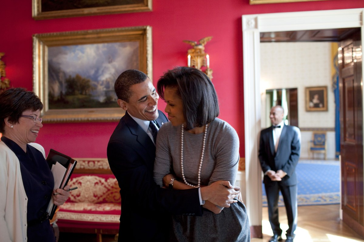 Barack Obama hugs Michelle Obama in the Red Room of the White House prior to the National Newspaper Publishers Association reception on March 20, 2009.