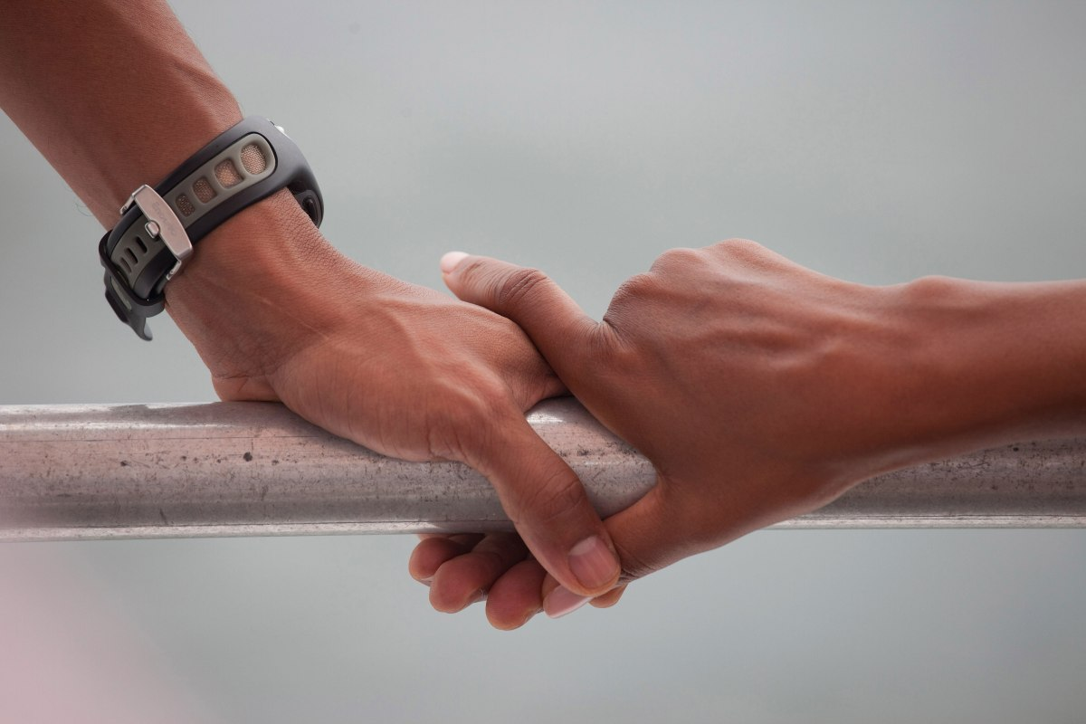 Barack Obama and Michelle Obama's hands rest on the railing of a boat during their tour of St. Andrews Bay in Panama City Beach, Fla., Aug. 15, 2010.