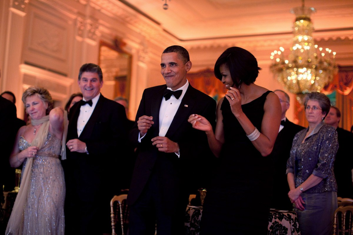 Barack Obama and Michelle Obama dance together during the Governors Ball in the East Room of the White House, Feb. 21, 2010.