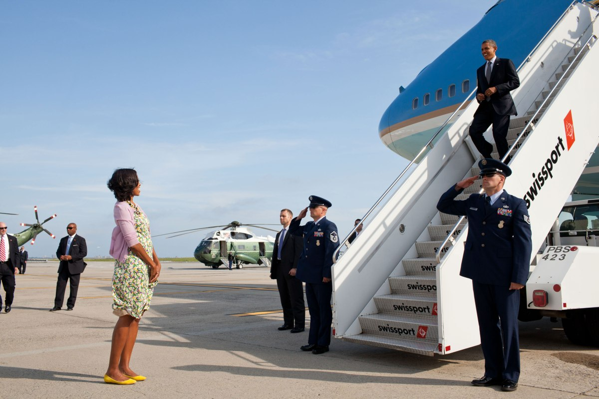 Michelle Obama waits to greet Barack Obama upon his arrival at John F. Kennedy International Airport in New York, N.Y., June 14, 2012.