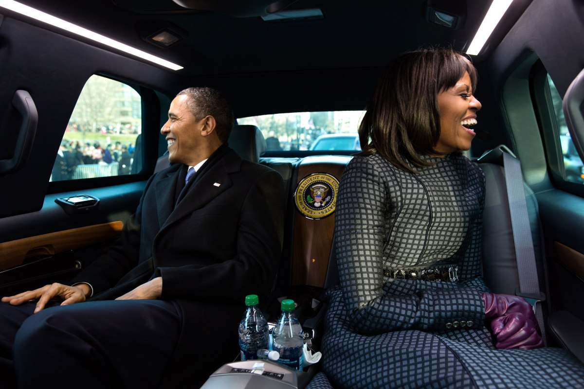 Barack Obama and Michelle Obama ride in the inaugural parade in Washington, D.C., Jan. 21, 2013.