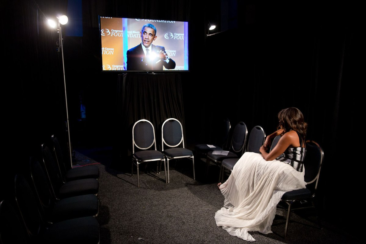 The First Lady backstage watching the President deliver remarks at the Congressional Black Caucus Foundation's 44th Annual Legislative Conference Phoenix Awards Dinner in Washington, D.C., Sept. 27, 2014.