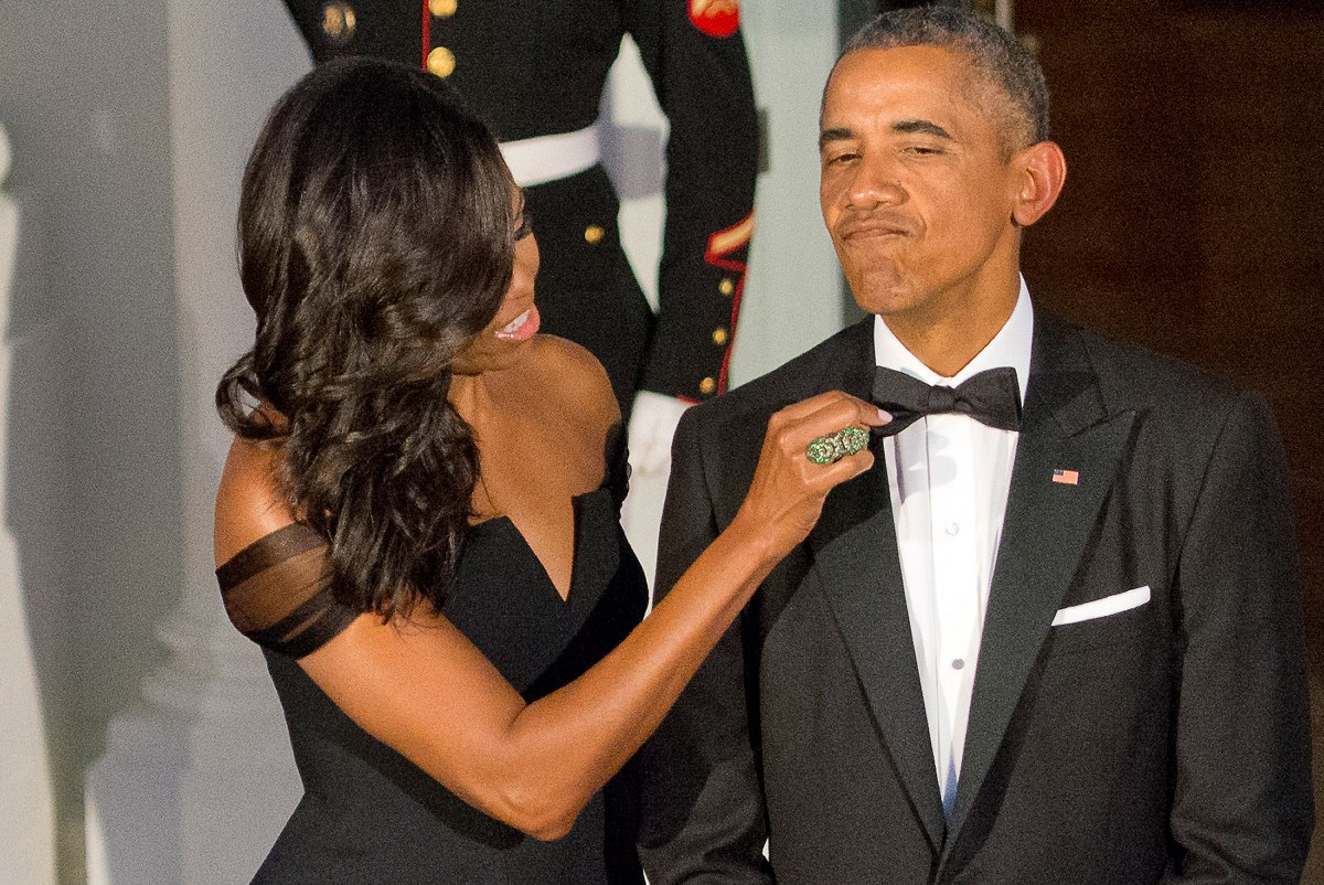 Michelle Obama adjusts the tie of Barack Obama as they prepare to welcome President XI Jinping of China and Madame Peng Liyuan to a State Dinner in their honor on the North Portico of the White House in Washington, D.C., on Sept. 25, 2015.