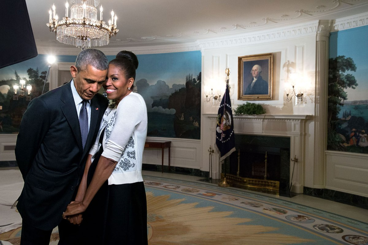 The First Lady snuggled against the President during a video taping for the 2015 World Expo in the Diplomatic Reception Room of the White House, March 27, 2015.