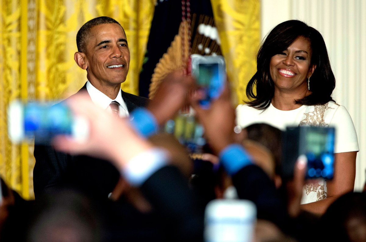 Barack Obama and Michelle Obama are seen above audience member cell phones as they host a reception celebrating African American History Month in the East Room of the White House in Washington, D.C., Feb. 18, 2016.