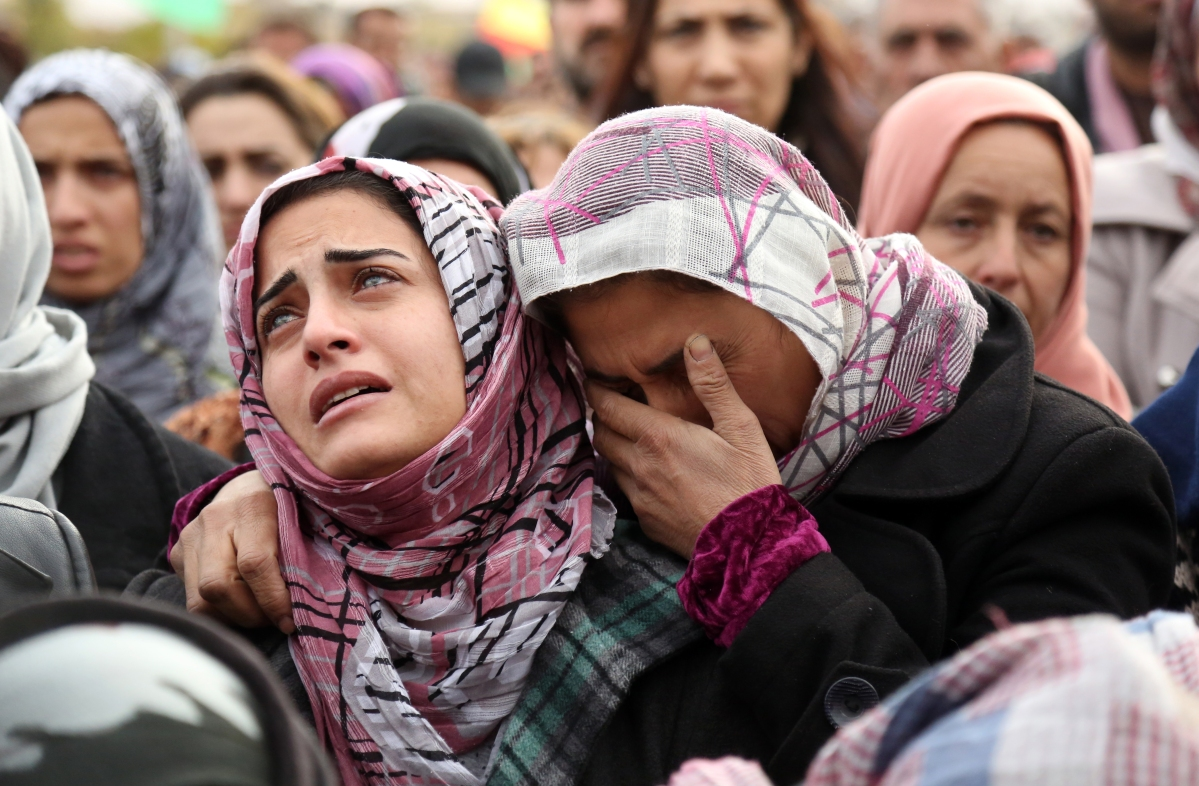 The sister of a man who died in a suicide bombing claimed by ISIS in the nearby town of Tal Tamr mourns during his funeral in Qamishli, in Syria's northeastern Hasakeh province, on Dec. 13, 2015.