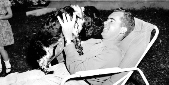 "Richard M. Nixon plays with his family's black and white cocker spaniel ""Checkers"" at his home in Washington on Sept. 28, 1952."