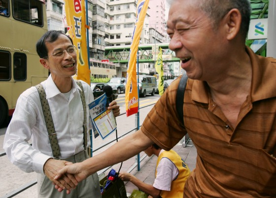 Tsang Yok-sing shakes hands with a supporter in Hong Kong.