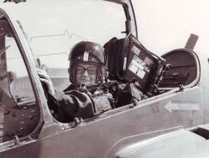 Clare in a jet, likely British RAF, during her time as Daily Telegraph defense correspondent, sometime between 1976 and 1981.