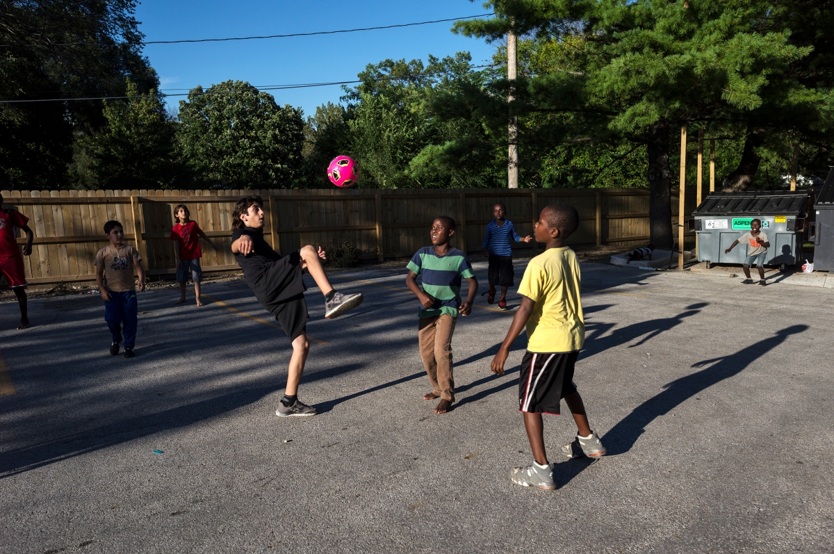 Nazeer plays soccer with other residents of the apartment complex where other refugee families have been settled.