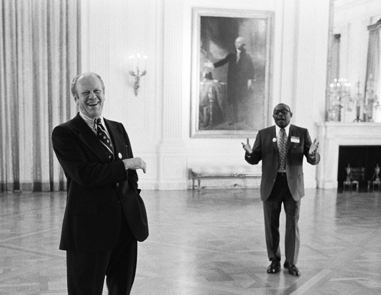 WASHINGTON Ñ 1975: President Gerald R. Ford in the East Room of the White House with Sikes McGee, his teammate from the 1930 South Grand Rapids High School football team, Washington, D.C., 1976. by David Hume Kennerly/Gerald R. Ford Presidential Library