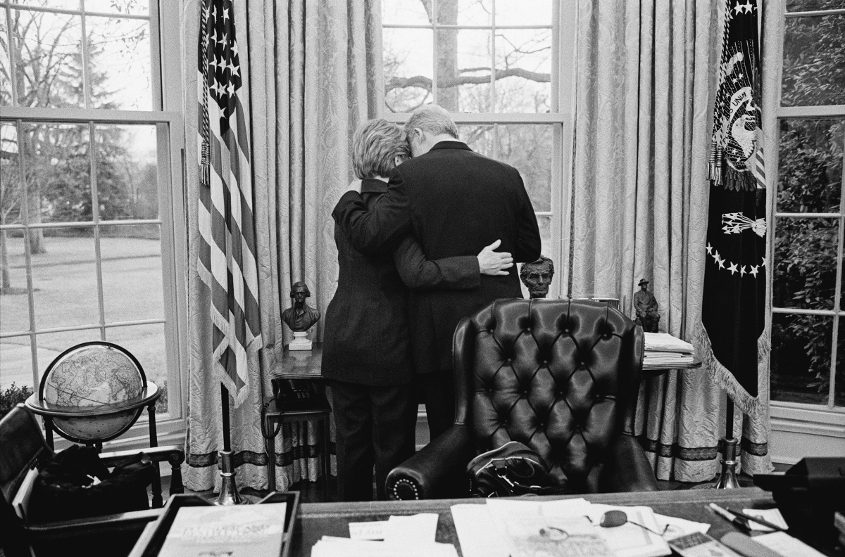 Bill Clinton and Hillary Clinton Share a private moment, one of their last in the Oval Office on Jan. 11, 2001.