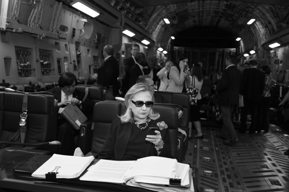 Hillary Clinton checks her messages upon departure from Malta for the as-yet-undisclosed location, Tripoli, Oct. 18, 2011.